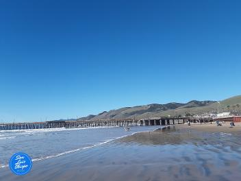 View of Pismo Beach pier and mountains